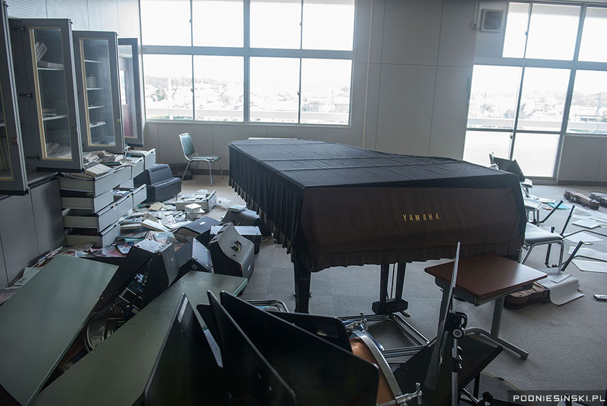 11-Musical instruments including a piano litter the floor of this classroom