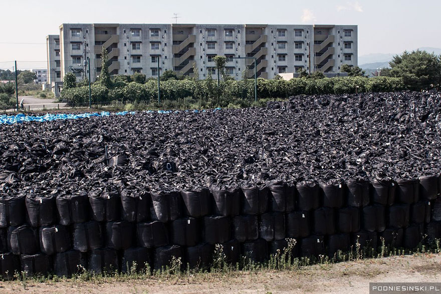 16-Bags of radioactive soil are stacked one on top of the other to save space
