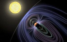 طرحی گرافیکی از میدان مغناطیسی احتمالی اطراف سیارهی b تاو گاوران